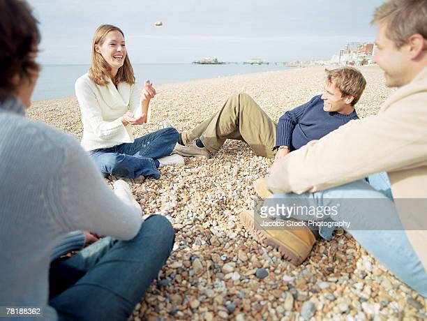 Friends relaxing at shore