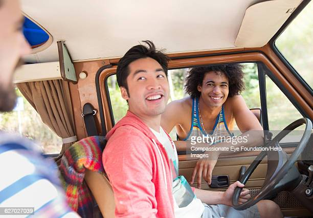 Friends relaxing in camper van