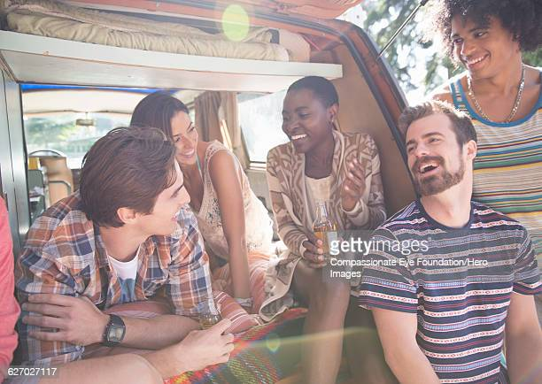 friends relaxing in camper van - five people stock pictures, royalty-free photos & images