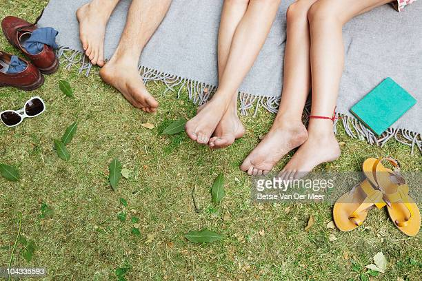 friends relaxing in park. - barefoot stock pictures, royalty-free photos & images