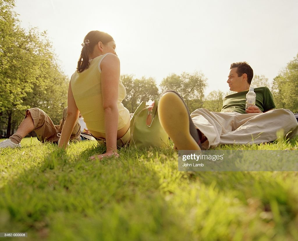 Friends Relaxing in Park : Stock Photo