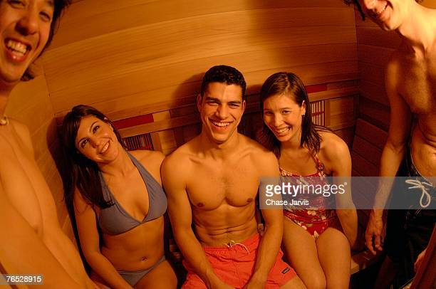 friends relaxing in sauna - skimpy bathing suits stock pictures, royalty-free photos & images