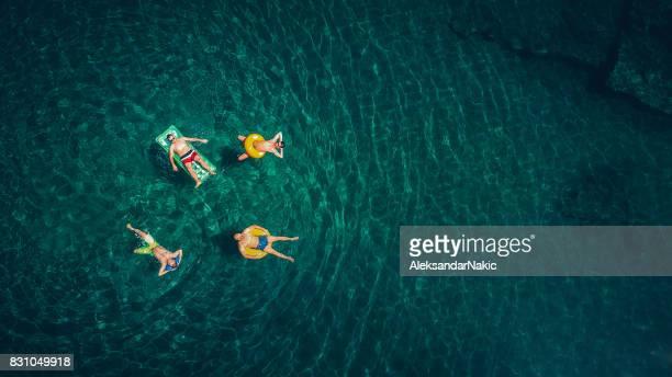 Friends relaxing in the ocean
