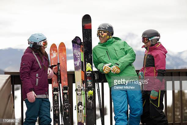 Friends relaxing on a patio, at a ski resort.
