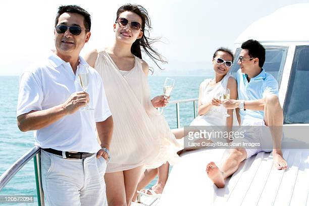 friends relaxing on a yacht - short sleeved stock pictures, royalty-free photos & images