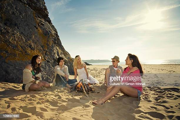 friends relaxing on beach - gower peninsula stock photos and pictures