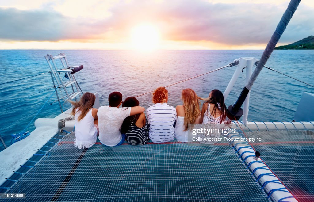 Friends relaxing on boat in ocean : Stock Photo