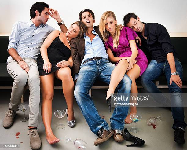 friends relaxing on couch after party - hangover after party stock pictures, royalty-free photos & images