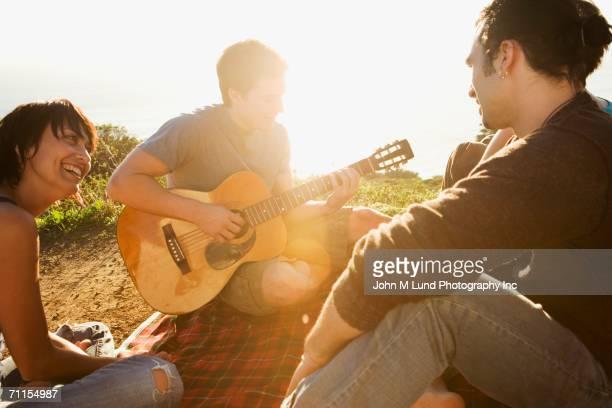 Friends relaxing outdoors
