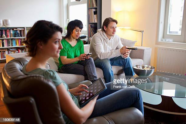 Friends relaxing together in living room