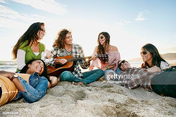 Friends relaxing together on beach