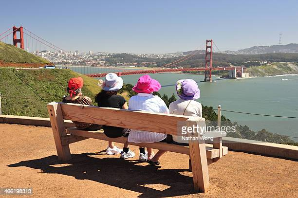 Friends relaxing while overlooking the Golden Gate Bridge.