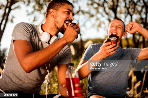 friends resting after exercise - multiculturalism stock pictures, royalty-free photos & images