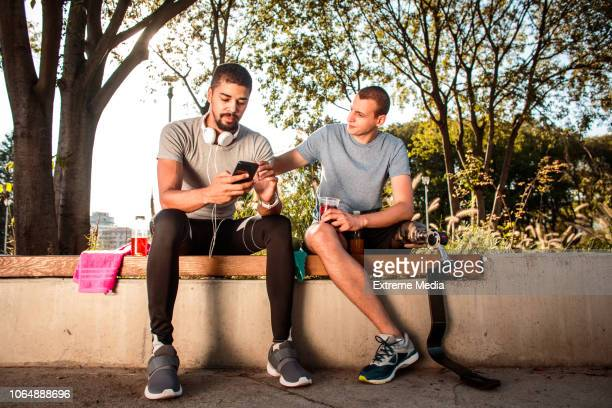 friends resting and hydrating after exercise - disabilitycollection stock pictures, royalty-free photos & images