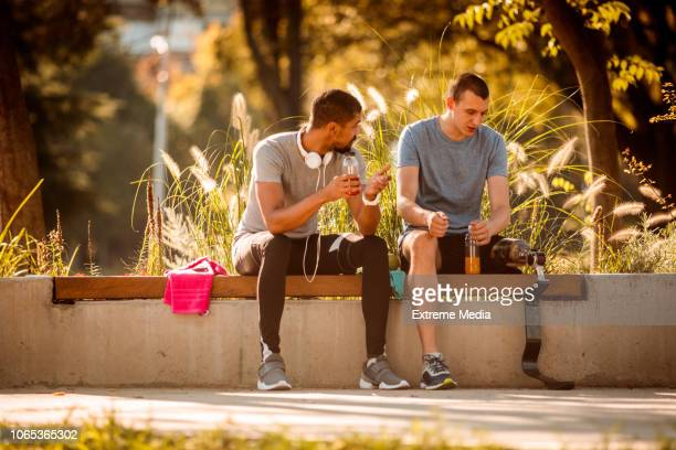 Friends resting and hydrating after exercise