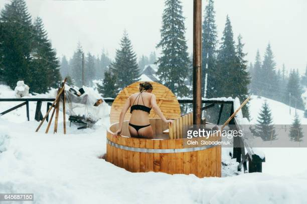 friends resting in wooden hot tub - hot tub stock photos and pictures