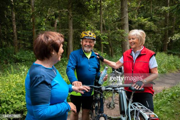 friends resting on a bike ride - morpeth stock pictures, royalty-free photos & images