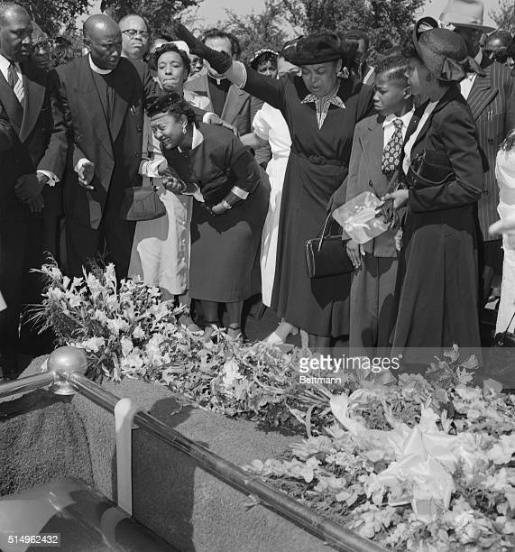 Friends restrain griefstricken Mrs Mamie Bradley as her son's body is lowered into the grave after a four day open casket funeral The 15year old...