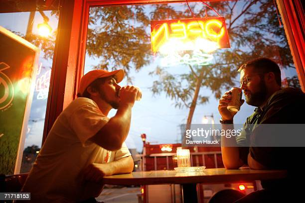Friends Ricky Kubicek and Andy Maring drink beers at the Nomad Pub on Milwaukee's east side August 25 2006 in Milwaukee Wisconsin Milwaukee was...