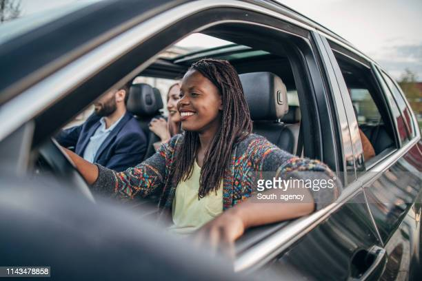 friends ride sharing - car pooling stock photos and pictures