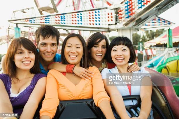 Friends riding a roller coaster