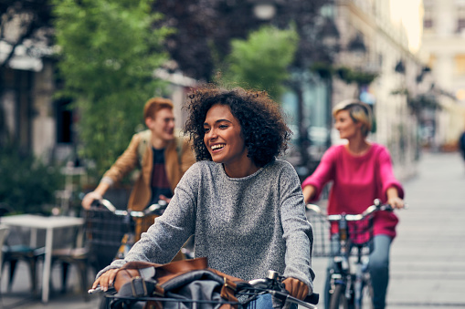 Friends Riding Bicycles In A City 1058884786