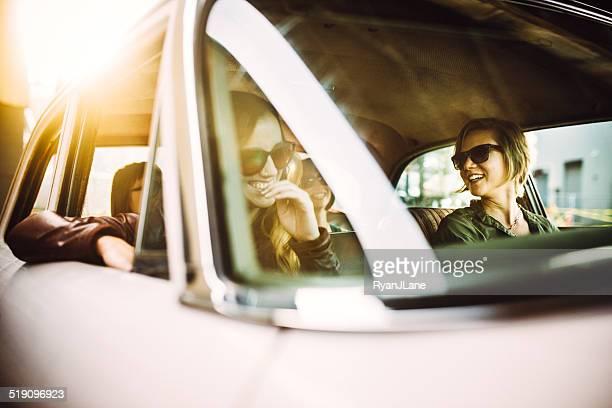Friends Riding in Classic Car