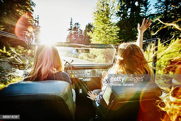 friends riding in convertible on summer evening - adults only stock pictures, royalty-free photos & images