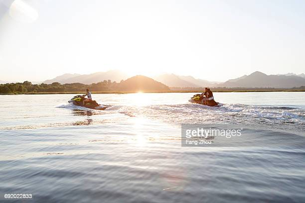 friends riding jet skis on lake, beijing, china - jet ski stock pictures, royalty-free photos & images