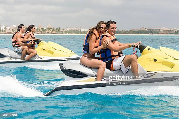 Friends riding jet skis