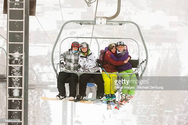 friends riding ski lift - ski lift stock pictures, royalty-free photos & images