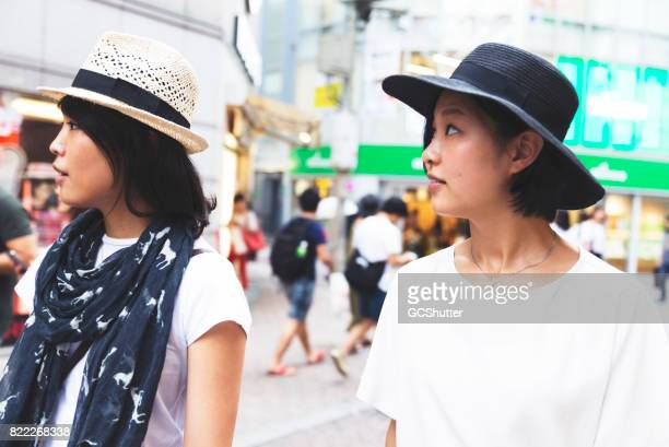 Friends roaming the streets of Shibuya Ward