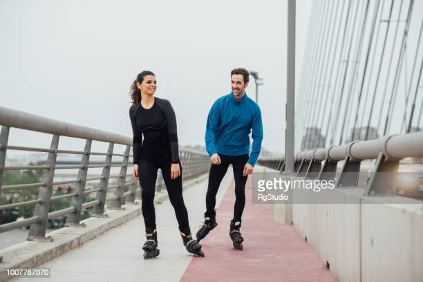 friends roller skating on the bridge - inline skate stock photos and pictures