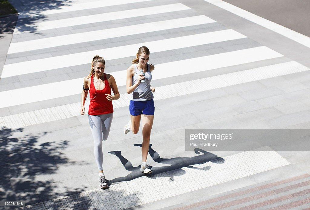 Friends Running Across Urban Crosswalk High-Res Stock ...