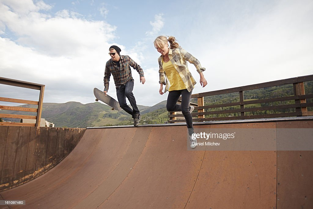 Friends running at a skate ramp. : Stock Photo