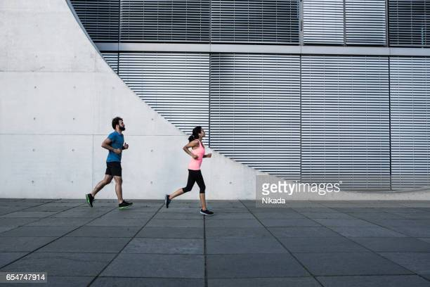 friends running in front of a building