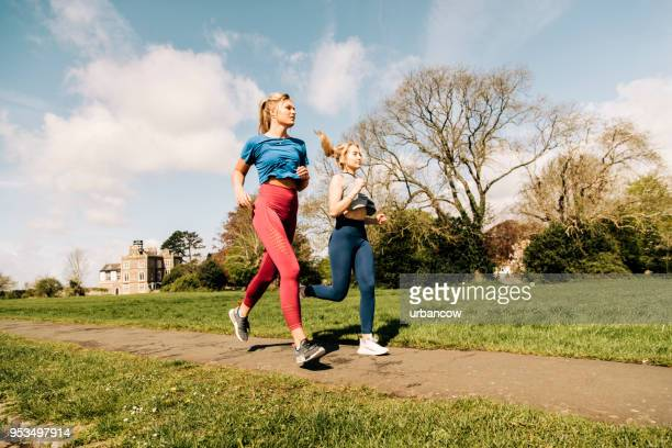 Friends running in the park
