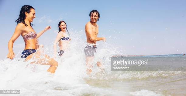Friends running in the sea