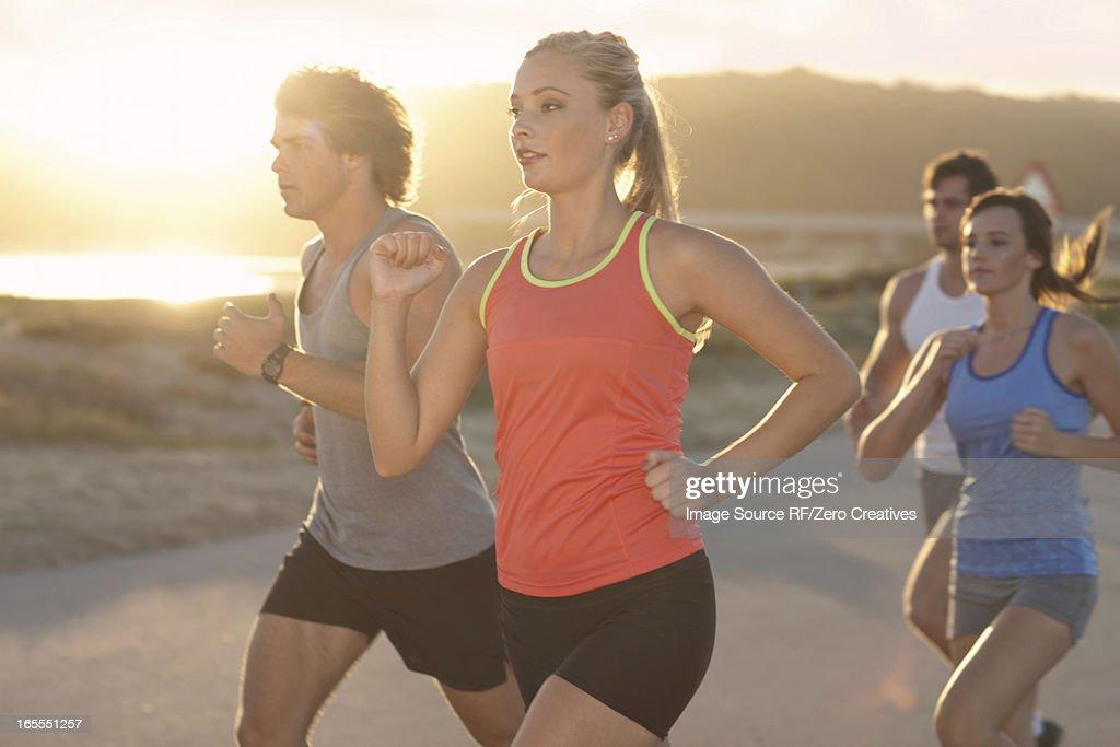 Friends running on beach : Stock Photo