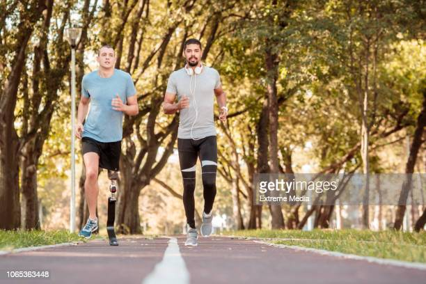 Friends running on the track