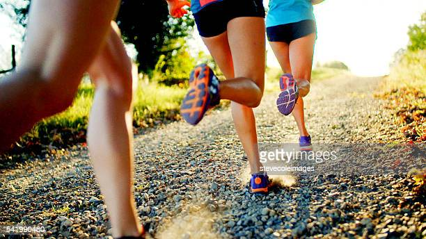 friends running - cross country running stock pictures, royalty-free photos & images