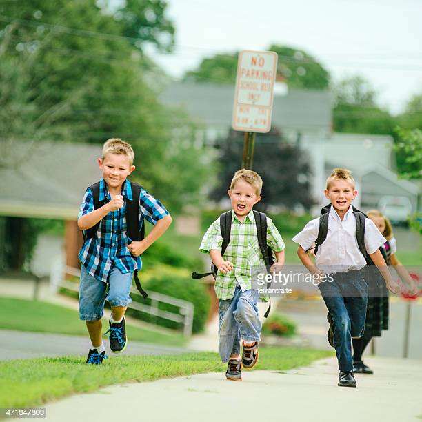 Friends running to school