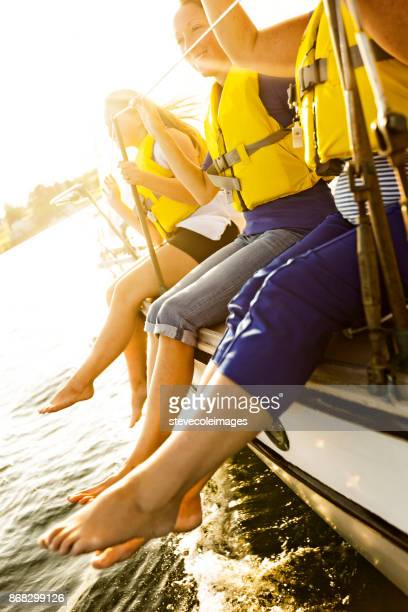 friends sailing - life jacket stock pictures, royalty-free photos & images
