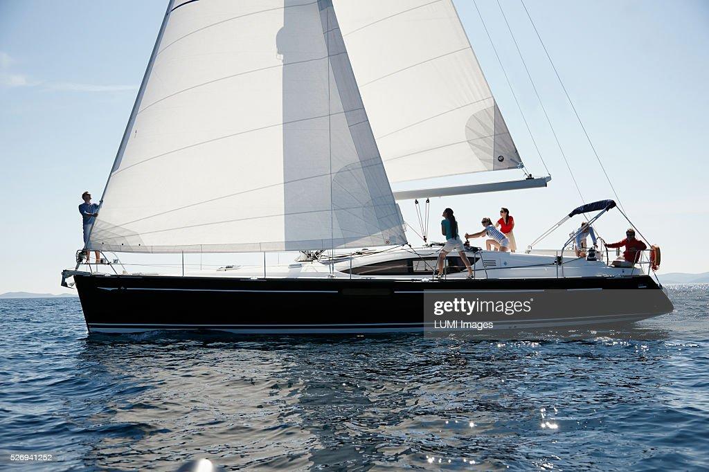 Friends sailing yacht, Adriatic sea : Stock Photo