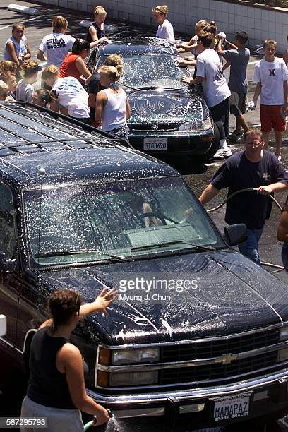 Friends schoolmates and members of Crescenta Valley Community Church wash cars in the church parking lot Friday afternoon as a way of raising money...