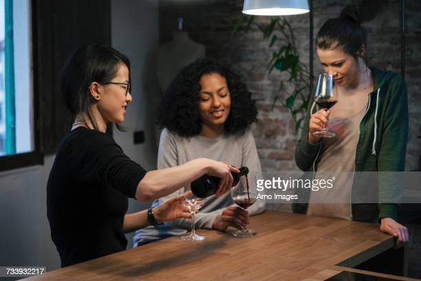 Friends sharing a bottle of red wine