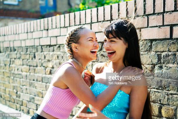 friends sharing a joke - laughing stock pictures, royalty-free photos & images
