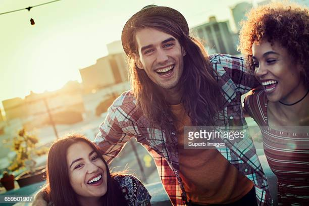 Friends sharing a laugh on urban rooftop