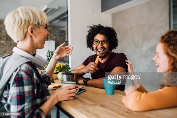 friends sharing a laugh - snack stock pictures, royalty-free photos & images