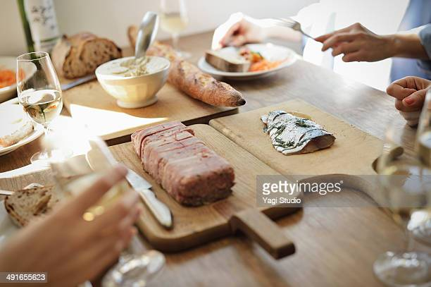 friends sharing a meal in the cafe in the early af - pate stock photos and pictures